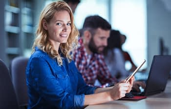 Blonde woman working at information technology developing company